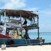 Boot auf der Koralleninsel Caye Caulke