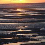 Sonnenuntergang am Strand von DeHaan