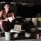Vigan City Pottery Worker
