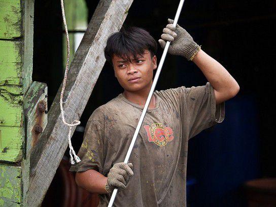 junger Schiffsjunge in Malaysia